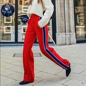 Zara red trousers with blue racer stripe